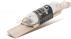 Royal salami with fine mould with a wooden board